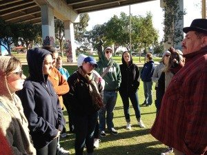 Chicano Park muralist Victor Ochoa engages Loyola students.