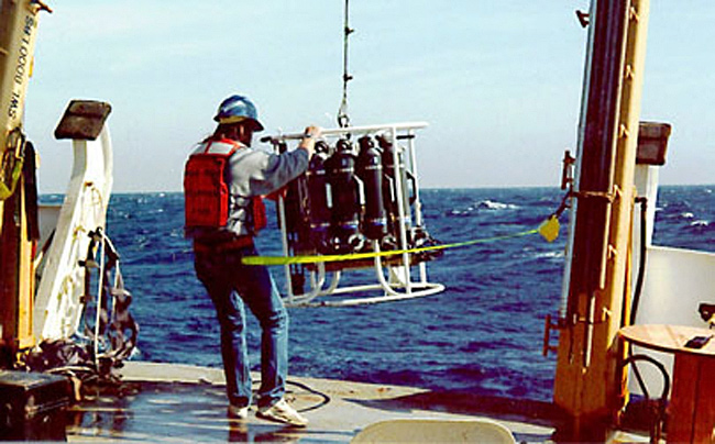 A NOAA photo of a CTD Device being launched