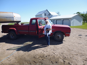 Judi with Cowboy's truck and trailer.