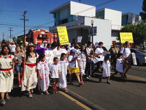 A Trail for Humanity's walkers and supporters march through Barrio Logan.