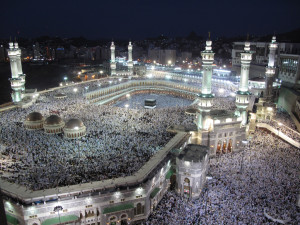 Worshipers flood the Grand mosque, its roof, and all the areas around it during night prayers