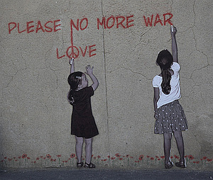 "Mural of two young girls writing ""PLEASE NO MORE WAR"" ""LOVE"" on a wall"