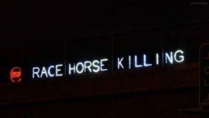 Overhead Light Brigade protest signage, via Facebook
