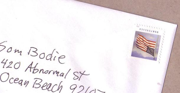 Envelope with upside-down stamp flag for postage
