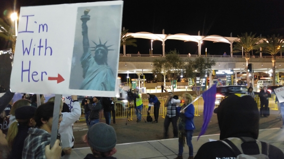 """""""I'm With Her"""" poster sign depicting Lady Liberty at Indivisible protest rally at Lindbergh Field airport"""