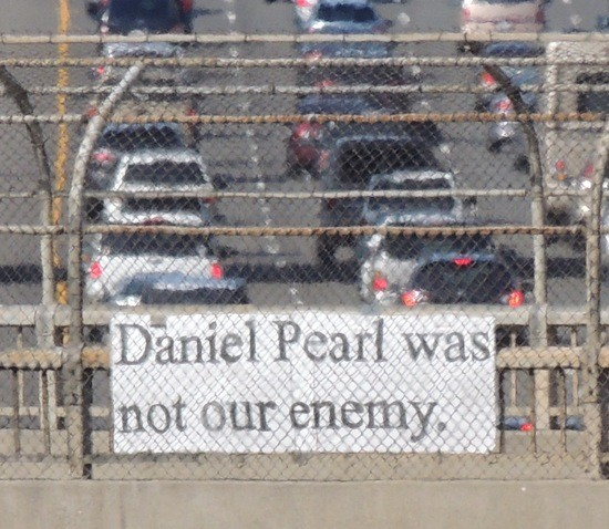 """Daniel Pearl was not our enemy"" banner on freeway overpass"